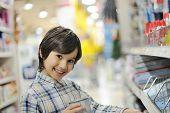 image of shoplifting  - Smiling kid in shopping mall - JPG