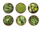 Fresh Green Vegetables Isolated On A White Background. Squash, Green Peas, Broccoli, Kale Leaves And poster