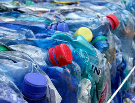 stock photo of plastic bottle  - Old dark blue plastic bottles prepared for processing and recycling - JPG