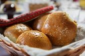 Wicker Basket With Freshly Baked Buns With Sesame Seeds