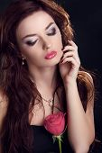 Beautiful Brunette Woman With Rose Flower. Glamour Portrait Of Female Makeup