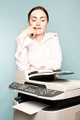 Businesswoman With Copier Thinking