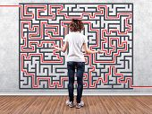 picture of riddles  - Photo of the girl before a wall with a labyrinth - JPG