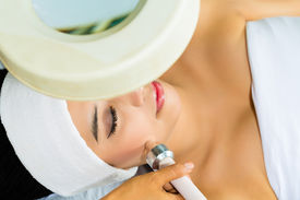 pic of ultrasonic  - Asian Woman lies in a beauty spa getting a treatment with ultrasonic - JPG