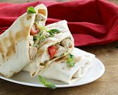 burrito (doner) with chicken and vegetables wrapped in pita bread