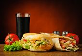 image of shawarma  - still life with traditional turkish kebab shawarma vegetables and cola - JPG