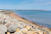 Dawlish Warren beach and rocks Devon England on blue sky summer day