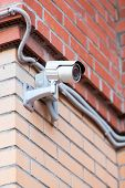 Video Surveillance Camera On Brick Wall