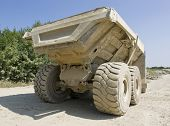 stock photo of dumper  - back side of a dirty dumper in sunny ambiance - JPG