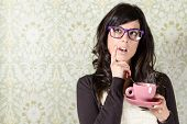 stock photo of guess  - Undecided woman thinking for making a decision on floral vintage wall background - JPG