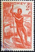 stamp printed by Dahomey shows Man Poling a Canoe