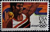 A stamp shows image of a shot putter and commemorates the 1984 Los Angeles Olympics
