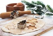 stock photo of christmas meal  - Kitchen utensil with raw Christmas cookies - JPG