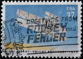 A stamp shows image celebrating the 100th anniversary of the first flight by the Wright Brothers