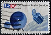 A stamp printed in USA dedicated to 200 years of postal service shows Communications Satellite
