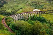 View Of A Steam Train On A Famous Glenfinnan Viaduct, Scotland