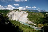 Rhine River Gorge In Swiss Alps, Switzerland. River Winding Under High Cliffs.