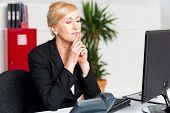 image of thinkers pose  - Lady thinking of a solution for client - JPG