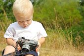 Baby Playing With Vintage Camera