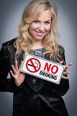Woman With No Smoking Sign.
