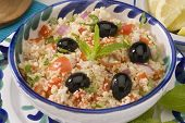 picture of tabouleh  - Tabouleh salad in a  blue ceramic bowl - JPG