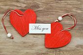 stock photo of miss you  - Miss you card with two red wooden hearts - JPG