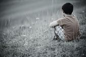 stock photo of knee  - Sad lonely kid - JPG