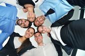 Closeup of happy business people with their heads together representing concept of ftiendship and te