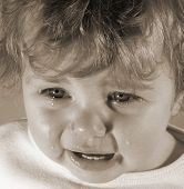 image of fussy  - baby crying in sepia tint - JPG