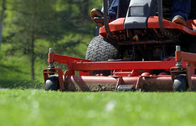 foto of grass-cutter  - view of a riding mower in action - JPG