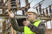 foto of substation  - Electrical Engineer gesturing in the electric substation - JPG