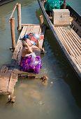 Traditional Burmese Washing In Lake Water