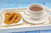 stock photo of churros  - Cup of hot chocolate and several Churros