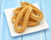 stock photo of churros  - Several fried churros with olive oil typical of Spain - JPG