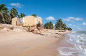 stock photo of natal  - Eroded beach with palms and house Pititinga Natal  - JPG