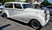 White Rolls Royce limo