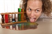 Crazy Woman Scientist With Test Tubes Lick