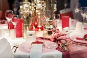 Elegant Table Set In Soft Red And Pink For Wedding Or Event Party.