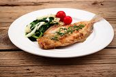 picture of flounder  - Fried flounder with onion cabbage and potato - JPG