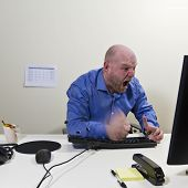 Angry Worker hit his keyboard