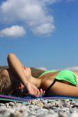 Erotic blonde sunbathing in the sun