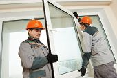 stock photo of windows doors  - Two male industrial builders workers at window installation - JPG