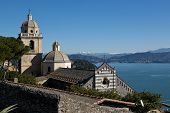 stock photo of promontory  - The historical church of San Pietro situated on the promontory of Portovenere facing Palmaria Island - JPG