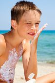 Child apply too much of sunblock cream