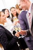 image of party people  - Image of beautiful female looking at her colleague while making toast - JPG