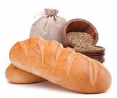 Bread, flour sack and grain isolated on white background cutout