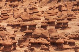 stock photo of goblin  - Mushroom Shaped Hoodoos Goblin Valley State Park Rock Canyon San Rafael Desert Utah USA Southwest - JPG