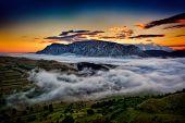 beautiful mountain landscape in foggy morning in Alba, Romania