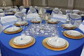 White dishes on blue tablecloth