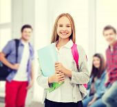 education and school concept - happy and smiling teenage girl